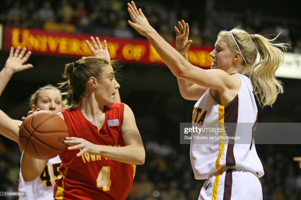 BRUCE BISPING ¥ bbisping@startribune.com Minneapolis, MN., Friday, 12/21/2007.]  Gopher Women Basketball vs. Iowa State.  (left)  Minnesota's Leslie Knight and (right) Emily Fox pressured Iowa States Alison Lacey (center) during a full court press in f : News Photo