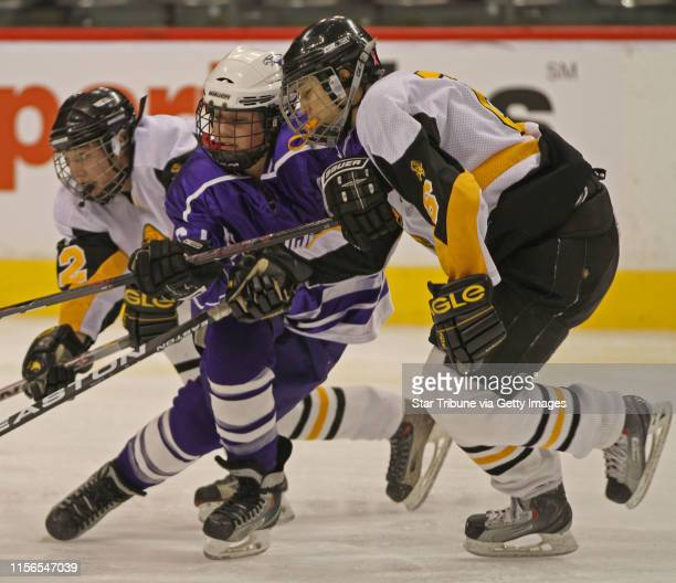 Bbisping@startribune.com St. Paul, MN., Wednesday, 2/23/11] Eveleth vs Red Wing Eveleth's Kaylen Erchul, Red Wing's Paige Haley and Eveleth's Kayla...