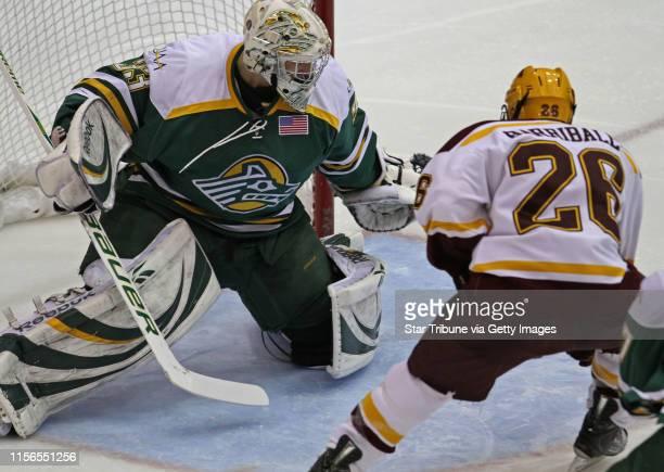 Bbisping@startribune.comMinneapolis, MN, Friday, 128/11] Gopher Hockey vs. Alaska Anchorage. Alaska goalie Rob Gunderson defended as Gophers Jay...
