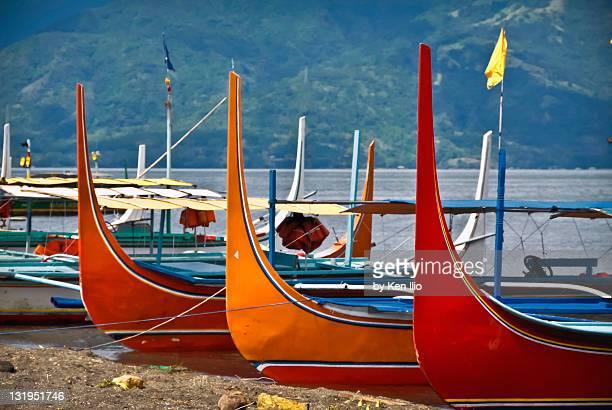 bboats moored on  shore of taal lake - taal foto e immagini stock