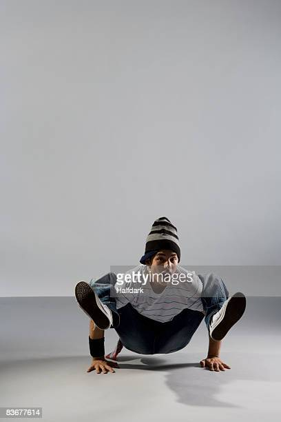 A B-boy doing a Crab breakdance move