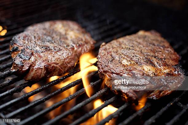 bbq ribeye steak grilling - seared stock photos and pictures