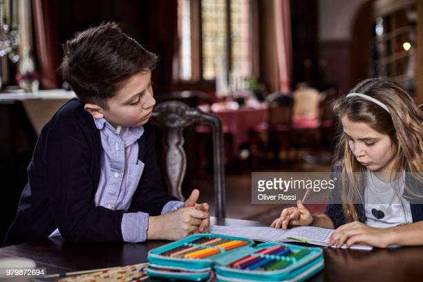 bbrother and sister doing homework together - pencil case stock pictures, royalty-free photos & images