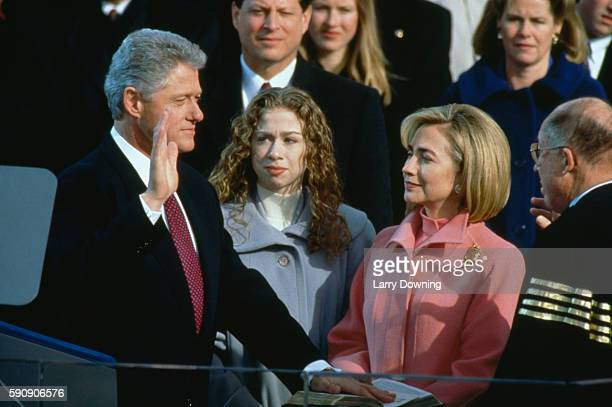 BClinton swears on the bible in front of Chelsea Hillary William Rehnquist A and TGore