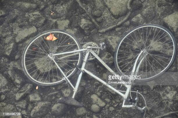 bcycle submersed in water. - emreturanphoto stock pictures, royalty-free photos & images