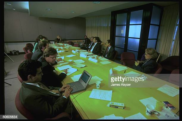 TIME Bd of Economists panelists Jerry Jasnowski Allen Sinai Audrey Freedman facing TIME eds across table mtg in NYC