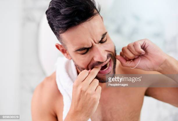 Be careful not to floss too vigorously to prevent dental damage