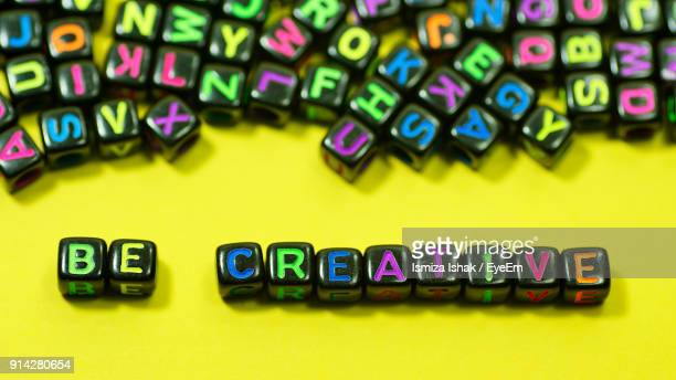 Be Creative Text With Colorful Alphabet Blocks On Yellow Background