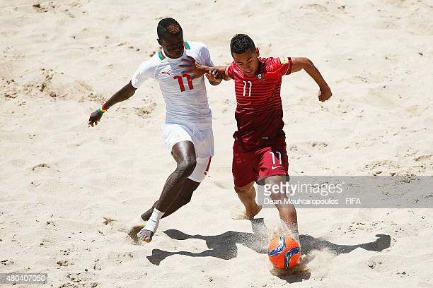 Be of Portugal battles for the ball with Ibrahima Balde of Senegal during the Group A FIFA Beach Soccer World Cup match between Senegal and Portugal...