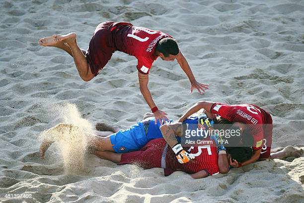 Be of Portugal jumps onto his team mates after winning the FIFA Beach Soccer World Cup Portugal 2015 Final between Tahiti and Portugal at Espinho...