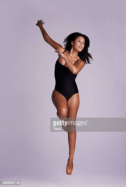 be the one who jumps a little higher - leotard stock photos and pictures