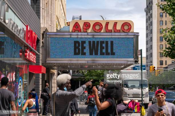 A Be Well sign is displayed on the marquis of the Apollo Theater in the Harlem neighborhood of New York US on Wednesday June 17 2020 New York City...
