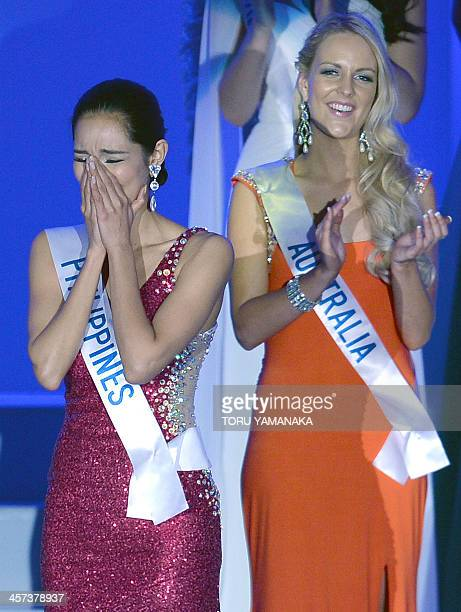 Bea Rose Santiago of the Philippines reacts after winning Miss International Beauty Pageant alongside Johanna Parker of Australia in Tokyo on...
