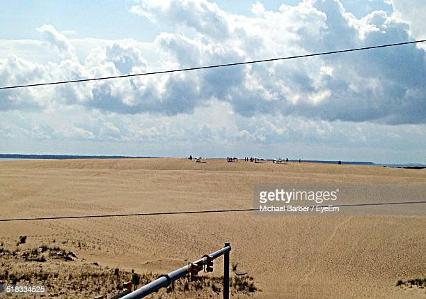 beach against cloudy sky - kitty hawk beach stock pictures, royalty-free photos & images