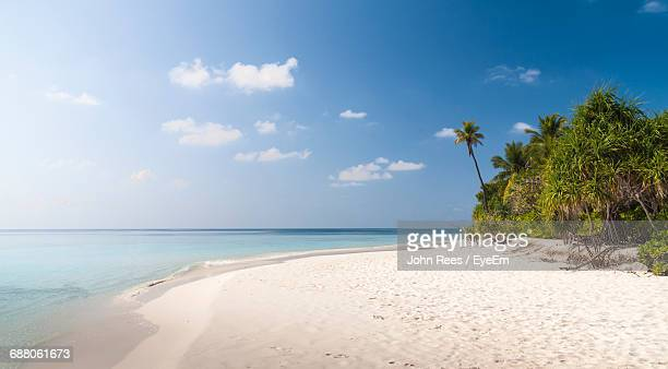 beach against sky - remote location stock pictures, royalty-free photos & images