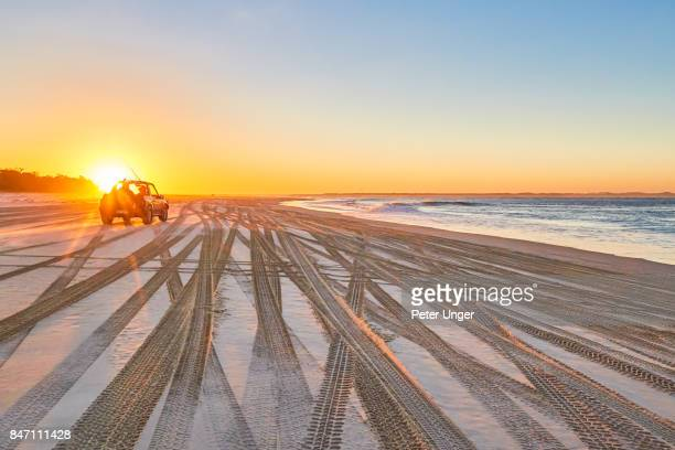 Beach and 4x4 vehicle at sunset,Amity Point,North Stradbroke Island,Queensland,Australia