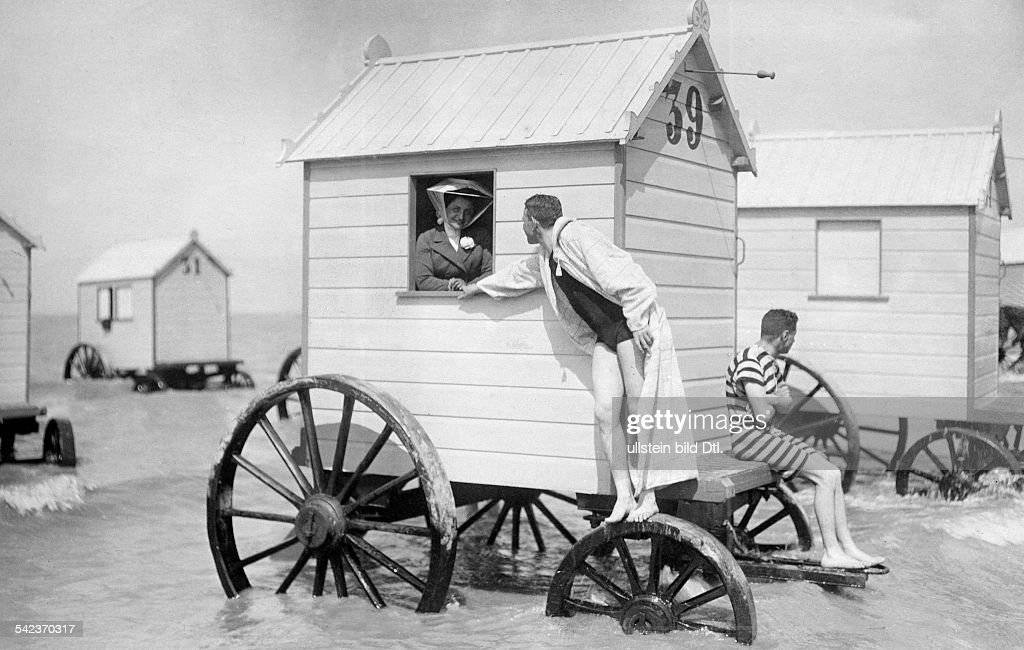 Beach and bathing scenes People at a beach wagon - undated
