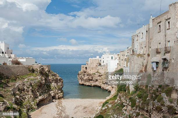 beach and bay of polignano a mare, puglia, italy - polignano a mare stock photos and pictures