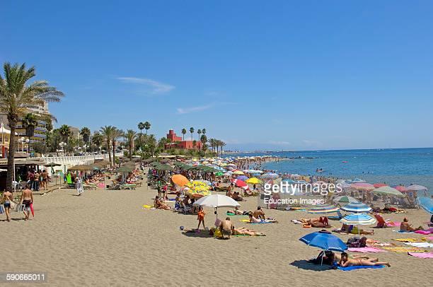Beach and Bil-Bil castle at background, Benalmadena, Malaga province, Costa del Sol, Andalucia, Spain.