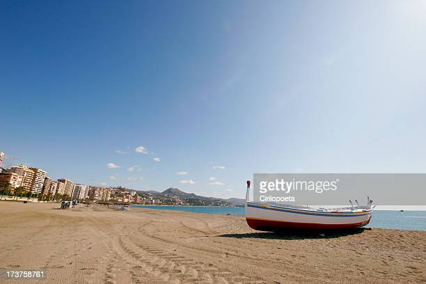 Beach and boat in Malaga