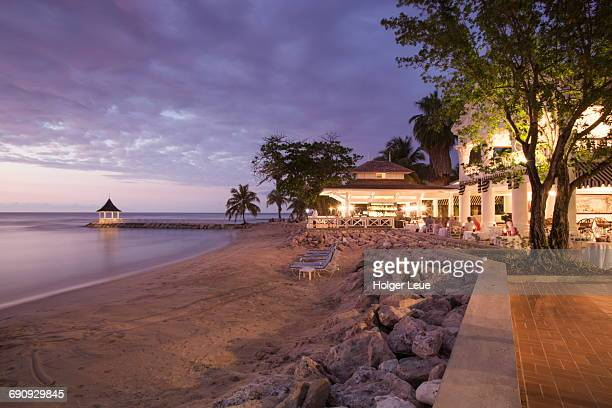beach and cedar bar at half moon resort at dusk - montego bay stock pictures, royalty-free photos & images