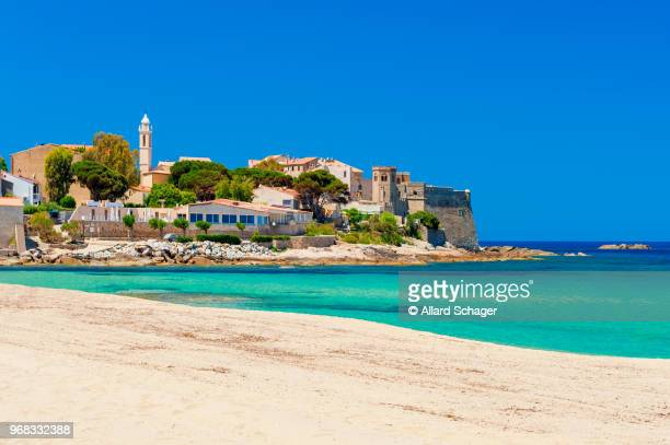 beach and coastline of algajola corsica - corsica stock-fotos und bilder
