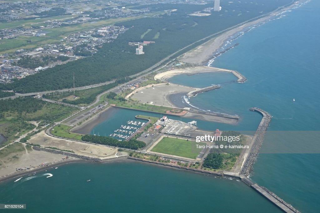 Beach and harbor in Miyazaki city in Miyazaki prefecture daytime aerial view from airplane : ストックフォト
