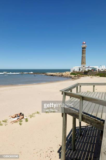 beach and lighthouse. jose ignacio. uruguay - jose ignacio lighthouse stock pictures, royalty-free photos & images