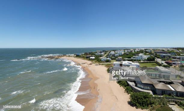 beach and lighthouse. jose ignacio. uruguay - jose ignacio lighthouse stock photos and pictures