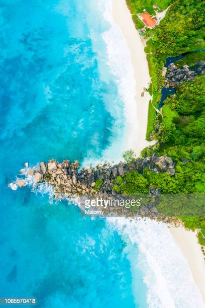 beach and ocean from above. aerial view, drone point of view, seychelles. - lagoon stock pictures, royalty-free photos & images