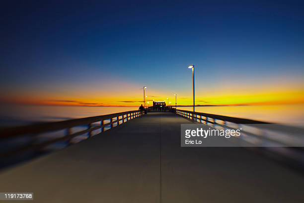 beach and pier at sunset - newport beach stock pictures, royalty-free photos & images