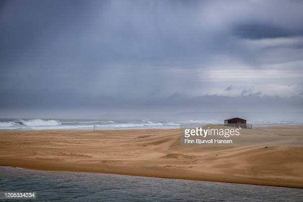 beach and sand dunes and a small cabin, atlantic ocean - finn bjurvoll stock pictures, royalty-free photos & images