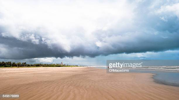 beach and storm - crmacedonio stock photos and pictures