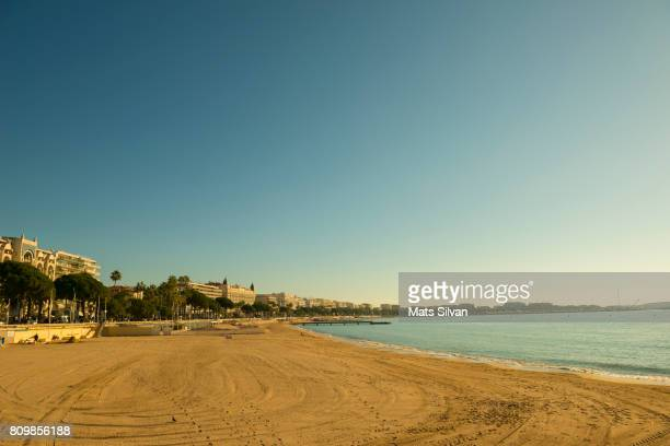 beach and the sea with city view in cannes - cannes stock pictures, royalty-free photos & images