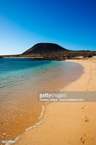 Beach and volcano on La Graciosa island