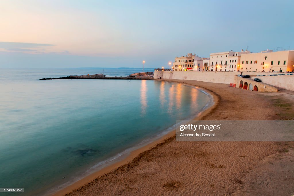 Beach and waterfront buildings at dusk, Lecce, Apulia, Italy : Stock Photo
