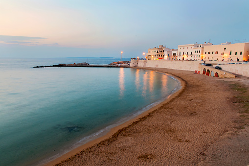 Beach and waterfront buildings at dusk, Lecce, Apulia, Italy - gettyimageskorea