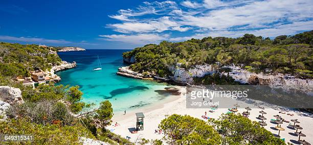 beach at cala lombards - majorca stock pictures, royalty-free photos & images