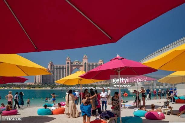 beach at dubai, near the famous palm . uae - arabian peninsula stock pictures, royalty-free photos & images