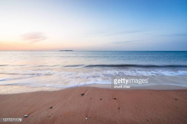beach at sunrise - tide stock pictures, royalty-free photos & images