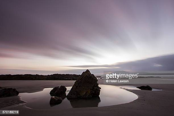Beach at sunset in Ireland with rockpool