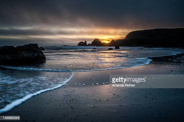 beach at sunset - amanda and amanda stock pictures, royalty-free photos & images