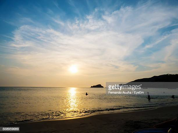 beach at sunset - barranquilla stock pictures, royalty-free photos & images