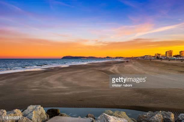 beach at sunset, riccione, rimini, italy - 沿岸 ストックフォトと画像