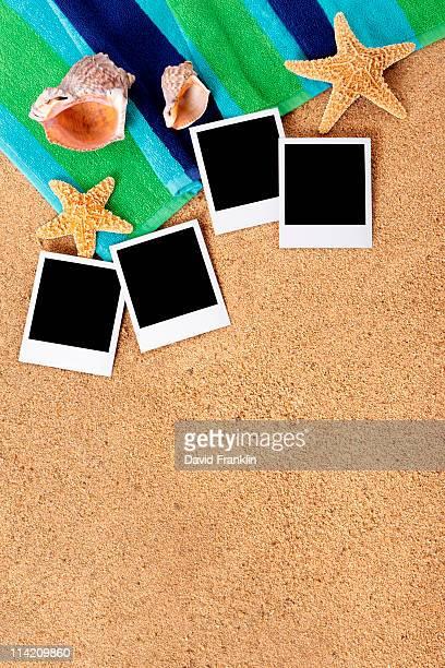 Beach background with blank polaroid photo prints.