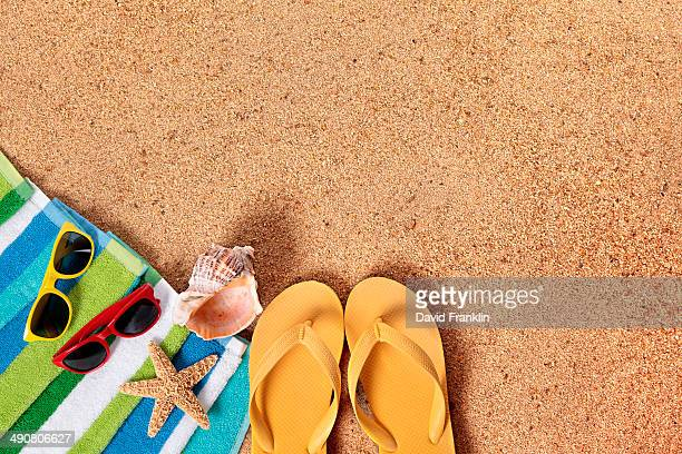 Beach background with flip flops and sunglasses