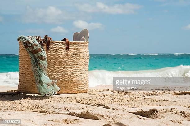 Beach bag on sandy beach, Mustique, Grenadine Islands