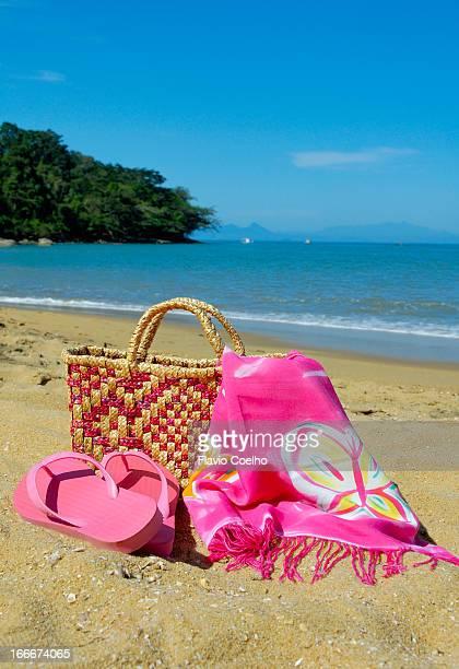 Beach bag on sandy beach