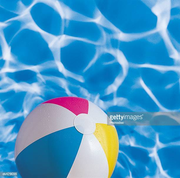 Beach ball and floating in water