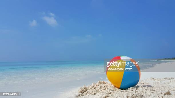 beach ball on white sandy beach and beautiful tropical sea - ビーチボール ストックフォトと画像